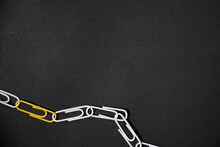 Yellow Paper Clip Chains, Unique Idea Concept On Black Background.