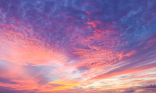 Flaming Beautiful Sunset Background Or Replacement Sky With Pinks And Organges And Yellow And Purple
