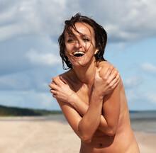 Naked Woman Posing On The Sea Beach