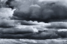 Dark Monochrome Heavy Storm Clouds Before A Thunderstorm Or Hurricane. Dramatic Clouds In Overcast Weather.