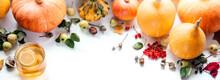 Autumn Thanksgiving Composition With Pumpkins, Lemon Tea, Acorns, And Acorns