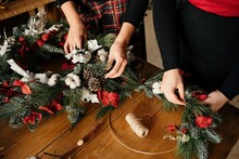 Anonymous Women Making Christmas Wreath Together