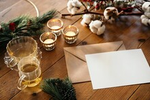 Christmas Composition With Blank Postcard On Wooden Table