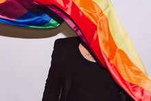 Gay Man Covering Face With LGBT Flag