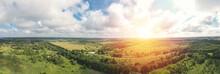 Asphalt Road Through Green Summer Field And Forest Near Farmland. Aerial Panoram