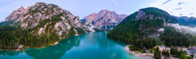 Beautiful Landscape Of Braies Lake Lago Di Braies, Romantic Place With Wooden Bridge And Boats On The Alpine Lake, Alps Mountains, Dolomites, Italy, Europe