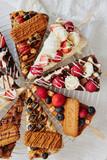 Fototapeta Kawa jest smaczna - Appetizing tasty cheesecake with fruits on sticks