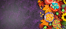 Halloween Trick Or Treat Social Media Web Banner. Candy And Lollipops, Autumn Leaves On Stylish Purple Textured Background. Top View Blog Hero Header Creative Flat Lay. Negative Copy Space.