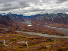 Expansive View Of The Autumn Tundra And Snowcapped Mountains Of Denali National Park, Alaska.