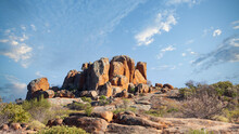 Rocky Outcrop Among Other Rocks Under A Blue Sky In The Australian Outback