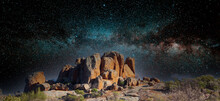 Merged Image Of A Rocky Outcrop Among Other Rocks  In The Australian Outback With An Image Of A Starry Sky