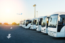 Buses At The Parking Lot Of The Airport At Sunrise. Holiday, Travel, Tourism And Vacation Concept.