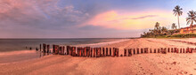 Old Pier In The Ocean At Port Royal Beach At Sunrise In Naples, Florida