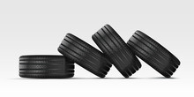 Car Tire With Cast Chrome Wheel. A Stack Of Car Tires Lie On Their Sides On Top Of Each Other. 4 Rubber Wheels For Summer And Winter On A White Background.