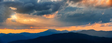 Majestic Sunset Sky Over Blue Mountains Landscape In Cloudy Day Of Rainy Season