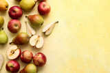 Ripe pears and apples on color background