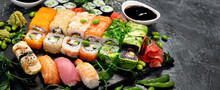 Sushi And Roll Set On Dark Background. Traditional Food Concept.