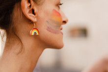 White Woman With Rainbow Sign On Her Cheek Smiling During Pride Parade