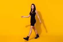 Full Body Profile Photo Of Sweet Brunette Hairdo Young Lady Go Wear Black Dress Isolated On Yellow Color Background