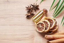 Essential Citrus Oil, Dried Lemon And Spice On Table ,