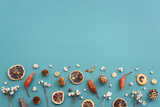 Top view image of autumn forest natural composition over blue background .Flat lay