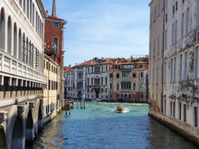 A Speedboat Sails Along One Of The Canals In Venice
