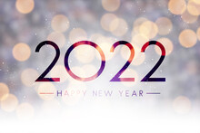 Fogged Glass 2022 Sign On Colorful Bokeh Background.