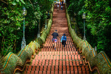Tourists Are Walking Up The Naga Stairs After Worshiping The Golden Pagoda At Wat Phra That Doi Suthep, A Famous Landmark Of Chiang Mai.