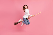 Full Length Profile Photo Of Brown Hairdo Millennial Lady Jump Wear Hoodie Jeans Sneakers Isolated On Pink Background