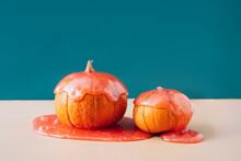 Two Beautiful Orange Pumpkins In Red Slime