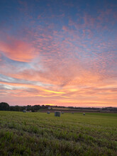 Ratingen, Germany - Beautiful Sunset In The Bergisches Land Region. Meadow In Straw Bales. Rural Landscape.