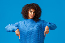 Upset And Gloomy Girl Waiting For Explanation, Feeling Uneasy And Depressed, Pointing Fingers Down, Looking Sad And Unhappy Camera, Standing Blue Background Distressed