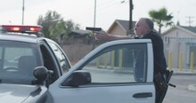 Police Officer Draws Gun On Suspect, Cop Jumps Out Of Police Car To Point Weapon At Perp, LAPD