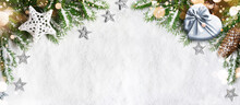 Christmas Background, Green Pine Branches, Gift Box On Snow Background And Light. Creative Composition, Top View. New Year's, Holiday, Christmas, Decoration.
