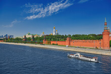 View Of The Moscow Kremlin From The Moscow River. Red Brick Towers And Bell Tower Of Ivan The Great. Grand Kremlin Palace. Travel To The Capital Of Russia. Moscow, Russia.