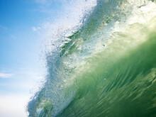 Backlit Breaking Wave In Summer