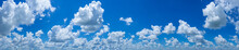 Panoramic Blue Sky Background With Many Clouds