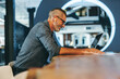 Leinwandbild Motiv Experienced businessman smiling during a virtual meeting