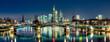 canvas print picture - Die Skyline von Frankfurt am Main am späten Abend mit dem Fluß Main im Vordergrund