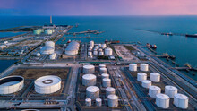 Aerial View Oil Tertminal Storage Tank, White Oil Tank Storage Chemical Petroleum Petrochemical Refinery Product At Oil Terminal, Business Commercial Trade Fuel Energy Transport By Tanker Ship Vessel.