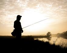 Beautiful Silhouette Fisherman Active Hobby Shade On Sunrise Landscape