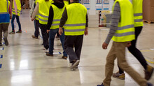 Team Of Delivery Workers With Yellow Jacket
