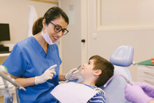 Dentists Near Smiling Boy At Appointment In Dental Clinic