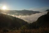 Fototapeta Kawa jest smaczna - Beautiful view of mountains covered with fog at sunrise