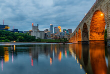 Mill Ruins Park And Stone Arch Bridge At Sunset