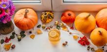 Autumn Creative Layout With Pumpkins, Lemon Tea, Acorns And Guelder Rose Berries