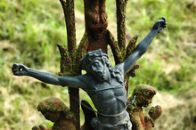 Jesus On Cross Fixed On An Old Rusty Cemetary Gate With Barbed Wire