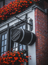 A Barrel Hanging On The Wall Of The Building