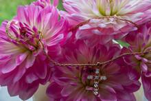 Gold Heart Earrings On Verbena Flowers