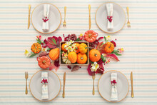 Festive Table Setting And Beautiful Autumn Decor In Restaurant